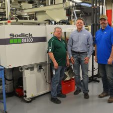 Viking Plastics Team in front of their Sodick Injection Molding Machine